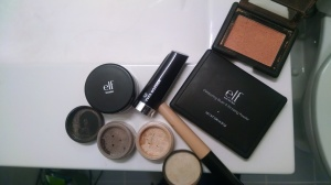 e.l.f. Mineral Booster in Shimmer; Yves Rocher Moisturizing Cream Lipstick in Rose Damas; Coastal Scents Mineral Eyeshadow in Nightingale; e.l.f. Eyeshadow in Natural; e.l.f. Eyelid Primer in Sheer; e.l.f. Contouring Blush & Bronzing Powder in St. Lucia; e.l.f. Studio Blush in Candid Coral.